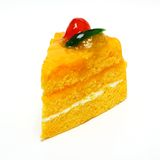 Orange cake isolated on white background. Orange cake with mixed fruit Royalty Free Stock Images
