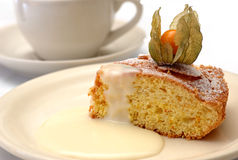 Orange cake with physalis. Royalty Free Stock Images