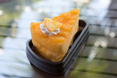 Orange cake. The orange cake with the orange piece cake on the table Royalty Free Stock Image