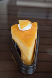 Orange cake. The orange cake with the orange piece cake on the table Stock Images