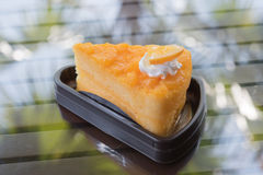 Orange cake. The orange cake with the orange piece cake on the table Stock Photo