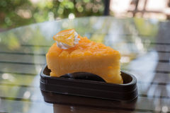 Orange cake. The orange cake with the orange piece cake on the table Royalty Free Stock Photography