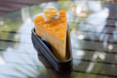 Orange cake. The orange cake with the orange piece cake on the table Stock Image