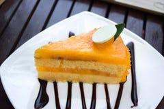 Orange cake. On a plate royalty free stock photos
