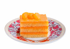 Orange cake in plate on  background Stock Photography
