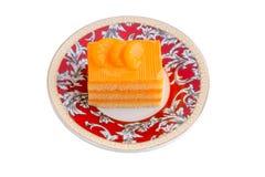 Orange cake in plate on white background Royalty Free Stock Photos