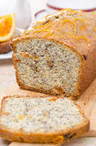 Orange cake with poppy seeds, dried apricots, walnuts and honey Royalty Free Stock Photo