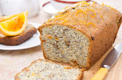 Orange cake with poppy seeds, dried apricots, walnuts and honey Stock Image