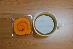 Orange cake roll and coffe Stock Photos