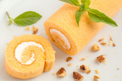 Orange cake roll on a plate Stock Images