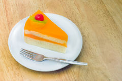 Orange cake  with slice kiwi fruit,cherry Royalty Free Stock Photo