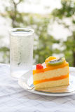 Orange cake and slice kiwi fruit Stock Photography