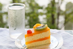 Orange cake and slice kiwi fruit Stock Photos