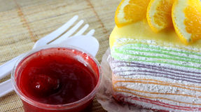 Orange cake and strawberry jam. Stock Photography