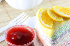 Orange cake and strawberry jam. Stock Images