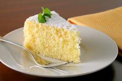 Orange cake and tea. Slice of orange cake with napkin on wood table Royalty Free Stock Images