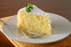 Orange cake and tea. Slice of orange cake with napkin on wood table Royalty Free Stock Photography