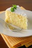 Orange cake and tea. Slice of orange cake with napkin on wood table Royalty Free Stock Photo