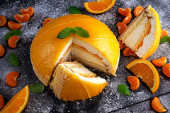 Orange Cake witch mousse, Mandarin saucea and fruit Royalty Free Stock Image