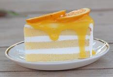 Orange cake. On wooden background Royalty Free Stock Images