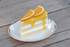 Orange cake. On wooden background Stock Photos