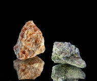 Orange calcite and chrome diopside are very beautiful Royalty Free Stock Photos