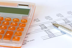 Orange Calculator and Pen for Accounting Royalty Free Stock Image