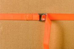 Orange cam buckle strap. An orange cam buckle strap stock photo