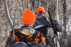 Orange camo. Hunters walking in orange camo Stock Images