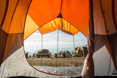 Orange camping tent on the mountain. View from inside Stock Photos