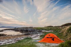 Orange Camping Tent Near Body of Water during Daytime Royalty Free Stock Photography