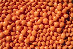 Orange Candies. Bright orange candies for a textured background Stock Photos