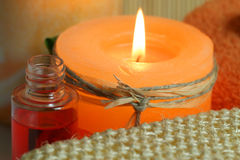 Orange candle Stock Images