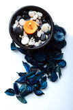 Orange candle and a blue potpourri Royalty Free Stock Photography