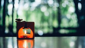 Orange candle with blurred background royalty free stock image