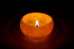 Orange candle. Oil candle made out of orange Stock Photos