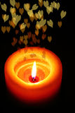 Orange Candle With Romantic Blur Hearts Vertical. View. Black Backround Stock Photos
