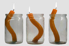 Orange candle. Three glass jars with candles inside Royalty Free Stock Photo