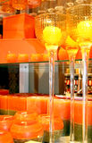 Orange candles. And candlesticks are in an interior Royalty Free Stock Photos