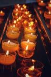 Orange candles light. Background. Orange candles light bright sparkle religion intelligence background royalty free stock photos