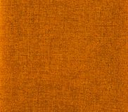 Orange canvas texture. Abstract colored image with orange cloth texture Stock Images