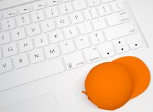 Orange cap on the keyboard Stock Photos