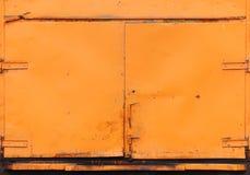Orange car door water carter as background. Stock Photo