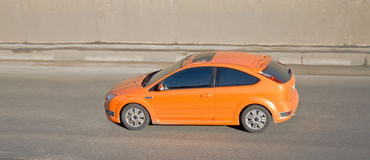 Orange car isolated Stock Image