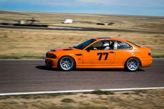 Orange car on race track. A numbered orange car on race track with motion blur Stock Photography