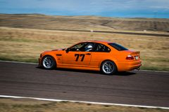 Orange car on race track. An orange car on race track with motion blur Royalty Free Stock Photo