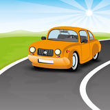 Orange car on the road. Stock Photos