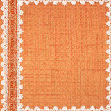 Orange card with flowers and white laces. Orange card with flowers, plants and white laces Royalty Free Stock Photo