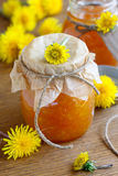 Orange and cardamom jam. With yellow flowers Stock Photo