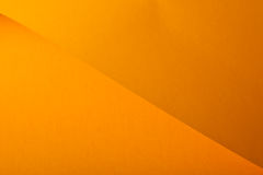 Orange  cardboard. Orange designer paper having the texture Royalty Free Stock Photo